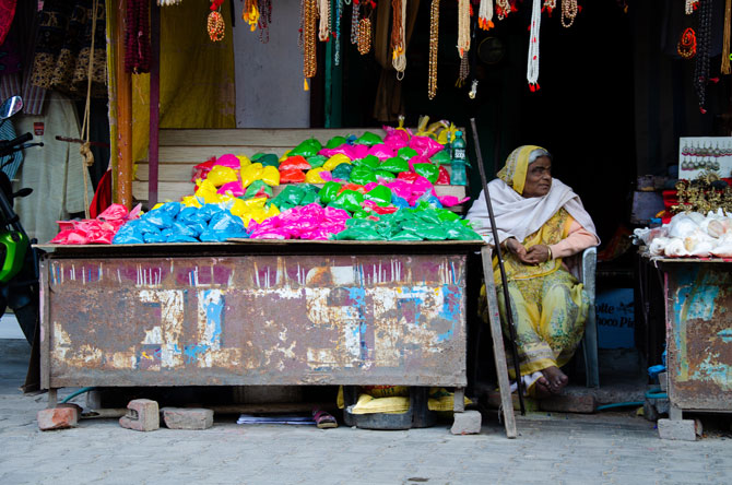 There you can see an old woman selling colors for the festival