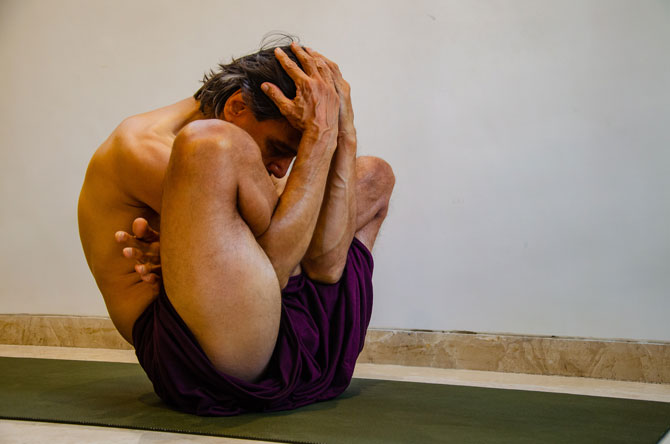 It is Garba Pindasana which a pose of Ashtanga Flow