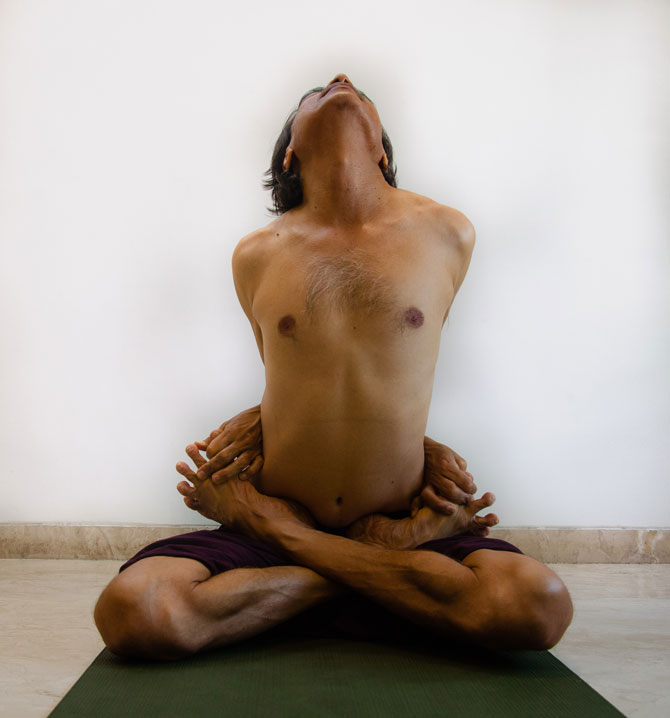 Outstanding asana called Baddha Padmasana shown by Yoga Teacher Sandeep Desai