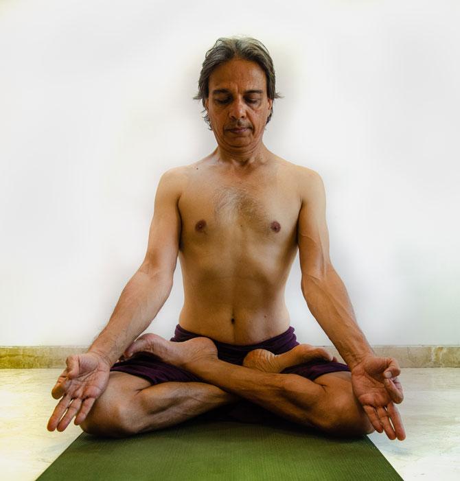 Meditating asana called Ardha Padmasana