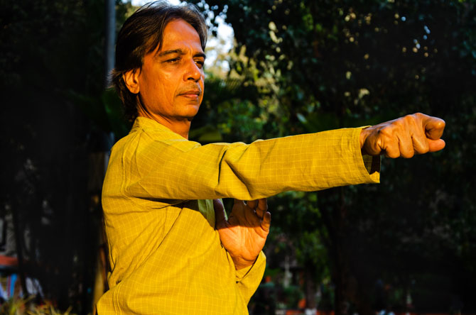 You can see Sandeep Desai from Mumbai showing Tai Chi pose