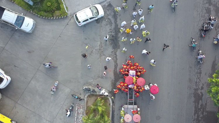 Picture from the drone while the family and monks are walking behind the coffin