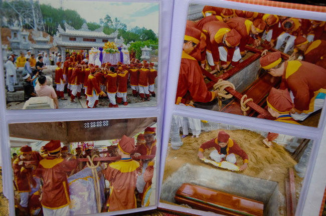 The burial by Vietnamese tradition. Monks are burying the coffin.