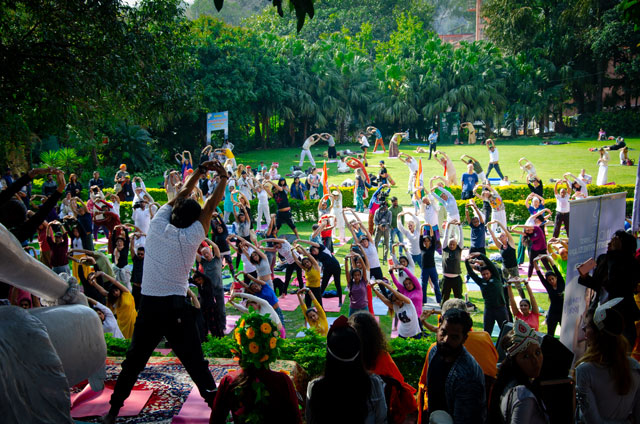 Many Yoga People are exercising outside in the Parmath Nikethan's garden.