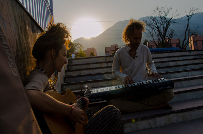 Omri and Ninka (Two musicians playing on two instruments) by the river Ganga in Rishikesh.