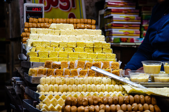 Counter full of Indian sweets.