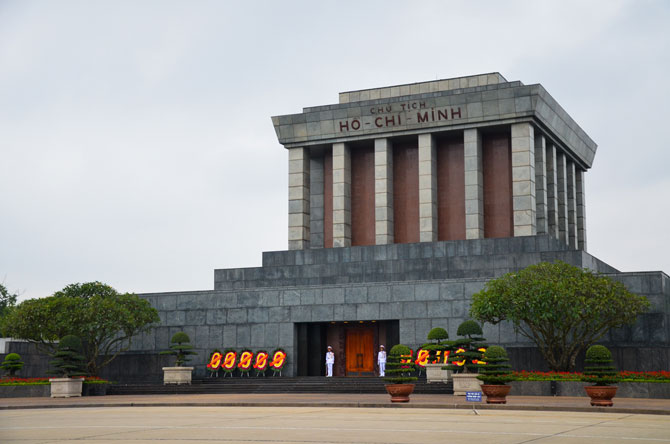 You can see Hanoi's Mausoleum Ho Chi Minh. A huge building where you can see green threes and two guards.