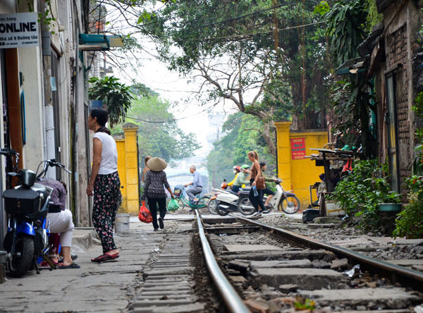 Hanoi's street where you can see a train on the trails.
