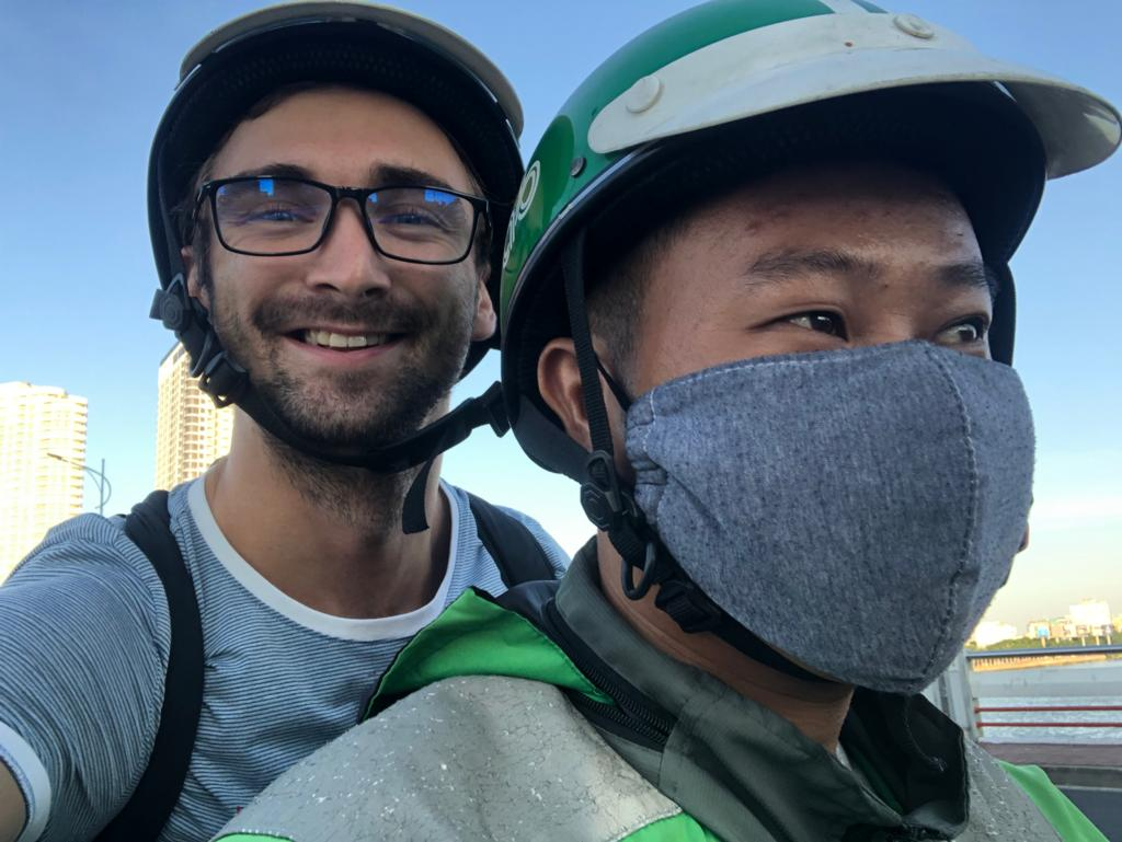 You can see to people (A driver of motorbike - Grab company) and me (Lubomir is smilling)