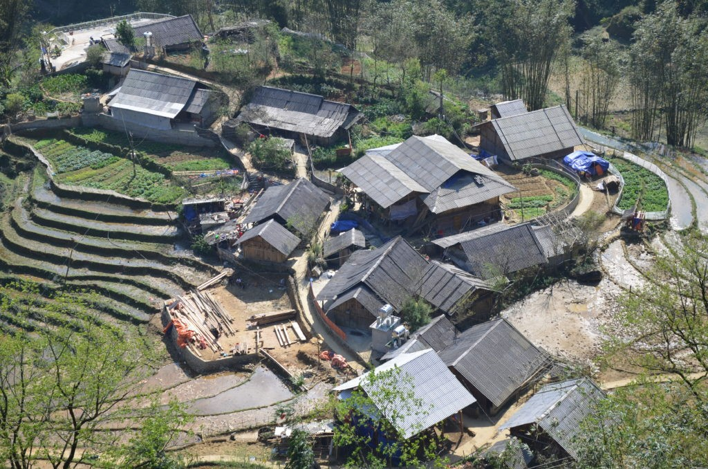 Typical local houses in Sapa. You can see the rice fields around them.